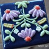 Flower quilt cookie with corn syrup/vodka glaze: Cookie and Photo by Yankee Girl Yummies