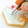 Placing Dewdrops on Colored Royal Icing: Cookie and Photo by Honeycat Cookies