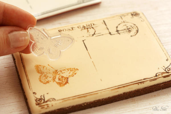 Stamping the iced cookie with butterfly stamp