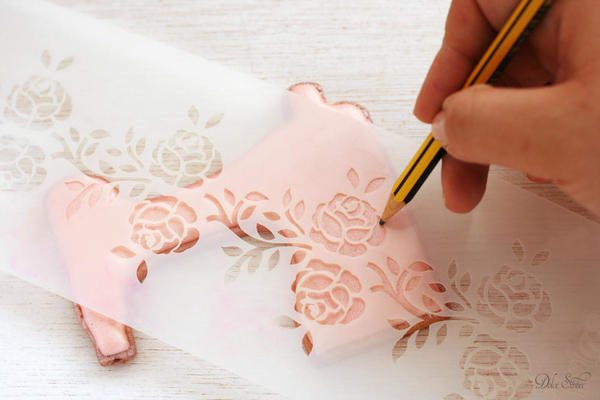 Using a stencils to trace roses: