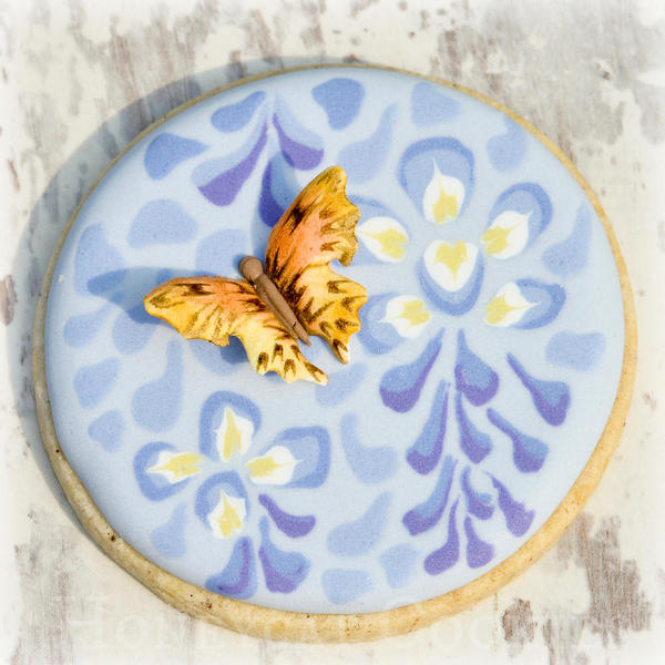 Butterfly attached to wisteria cookie