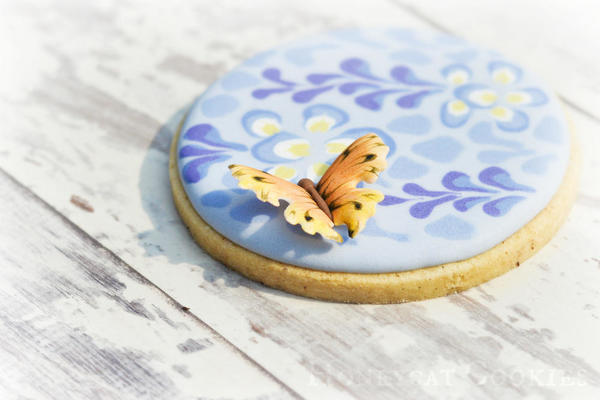 Butterfly and wisteria cookie close up