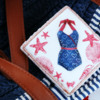 Navy-Chic Swimsuit Cookie - Where We're Headed!: Cookie and Photo by Dolce Sentire
