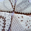 White Needlepoint Hearts: Cookies and Photo by by Natasha Rusak
