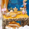 Cookie Side Table with Perfume Bottles: Cookies and Photo by Shelby Bower
