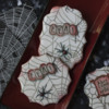 Jazzed-Up Three-Color Spider Cookies - A Closer View: Cookies and Photo by Julia M Usher; Stencils Designed by Julia M Usher in Partnership with Confection Couture Stencils