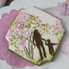 Another Mother and Child Cookie, Super Close-up: Cookie and Photo by Julia M Usher; Stencils Designed by Julia M Usher in Partnership with Confection Couture Stencils