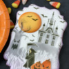 Two Dimensional Elements - Moon Royal Icing Transfer and Jack-o-Lantern Fondant Appliqué: Cookie and Photo by Julia M Usher; Stencils Designed by Julia M Usher with Confection Couture Stencils