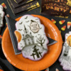 """Trick or Treat"" Message in Oval Frame: Cookies and Photo by Julia M Usher; Stencils Designed by Julia M Usher with Confection Couture Stencils"