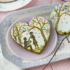 Cookie with Man-Proposing Foreground Element: Cookies and Photo by Julia M Usher; Stencils Designed by Julia M Usher with Confection Couture Stencils