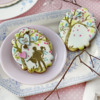 Cookie with Man-Holding-Woman Foreground Element and Fondant Appliqué Message: Cookies and Photo by Julia M Usher; Stencils Designed by Julia M Usher with Confection Couture Stencils