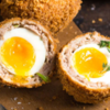 Scotch Egg: Image taken from https://nerdswithknives.com/scotch-eggs-runny-yolk/
