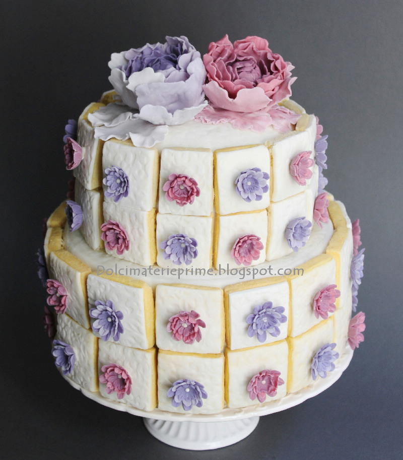 Flowers cookies on a cake