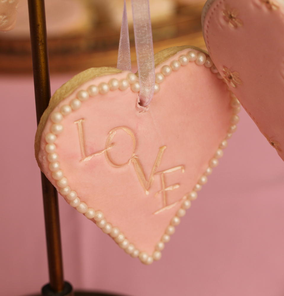 Fondant covered Loveheart cookie with 'Love' text