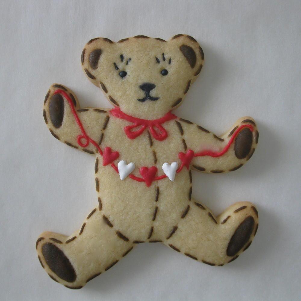 teddy bear with paper heart cut
