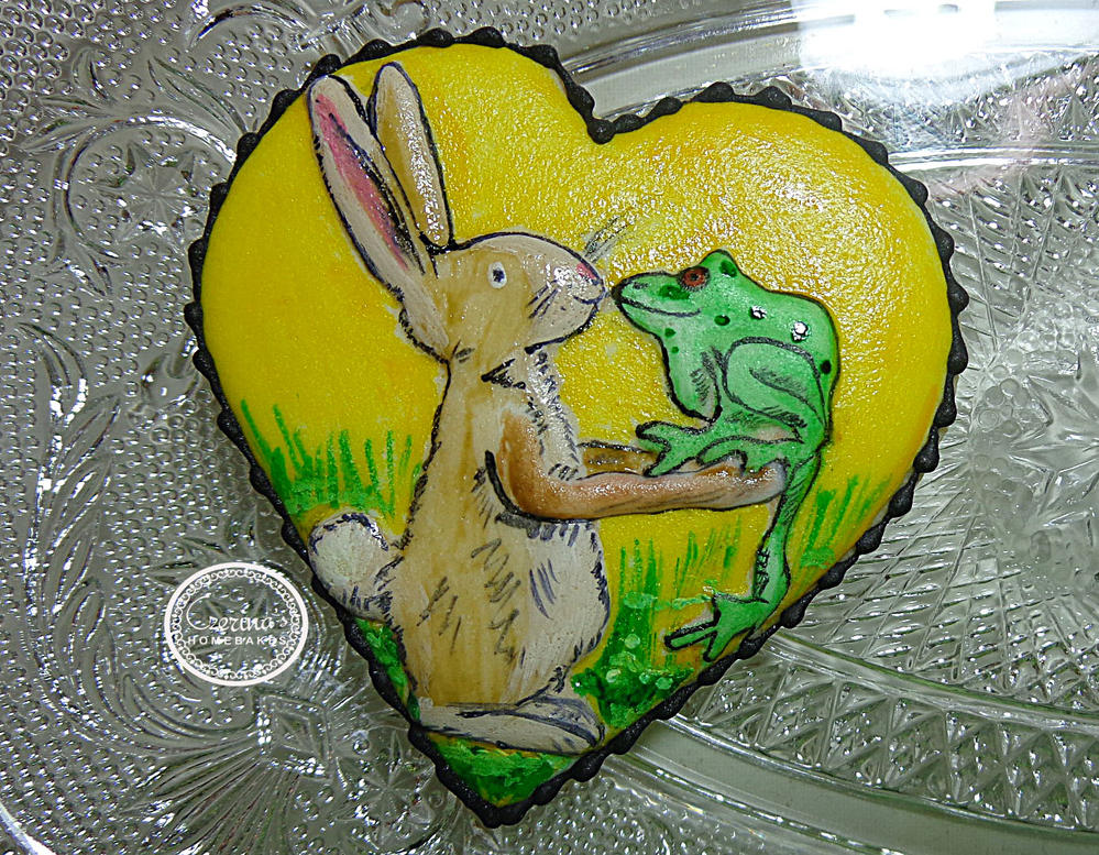 Hand painted rabbit and frog cookie.