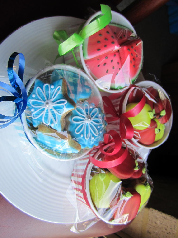 Little tubs of apples. watermelon and blue designs ready for the shop