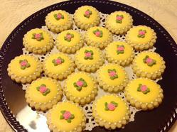 Yellow cookies with pink roses.