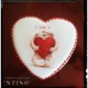 Teddy bear holds a heart