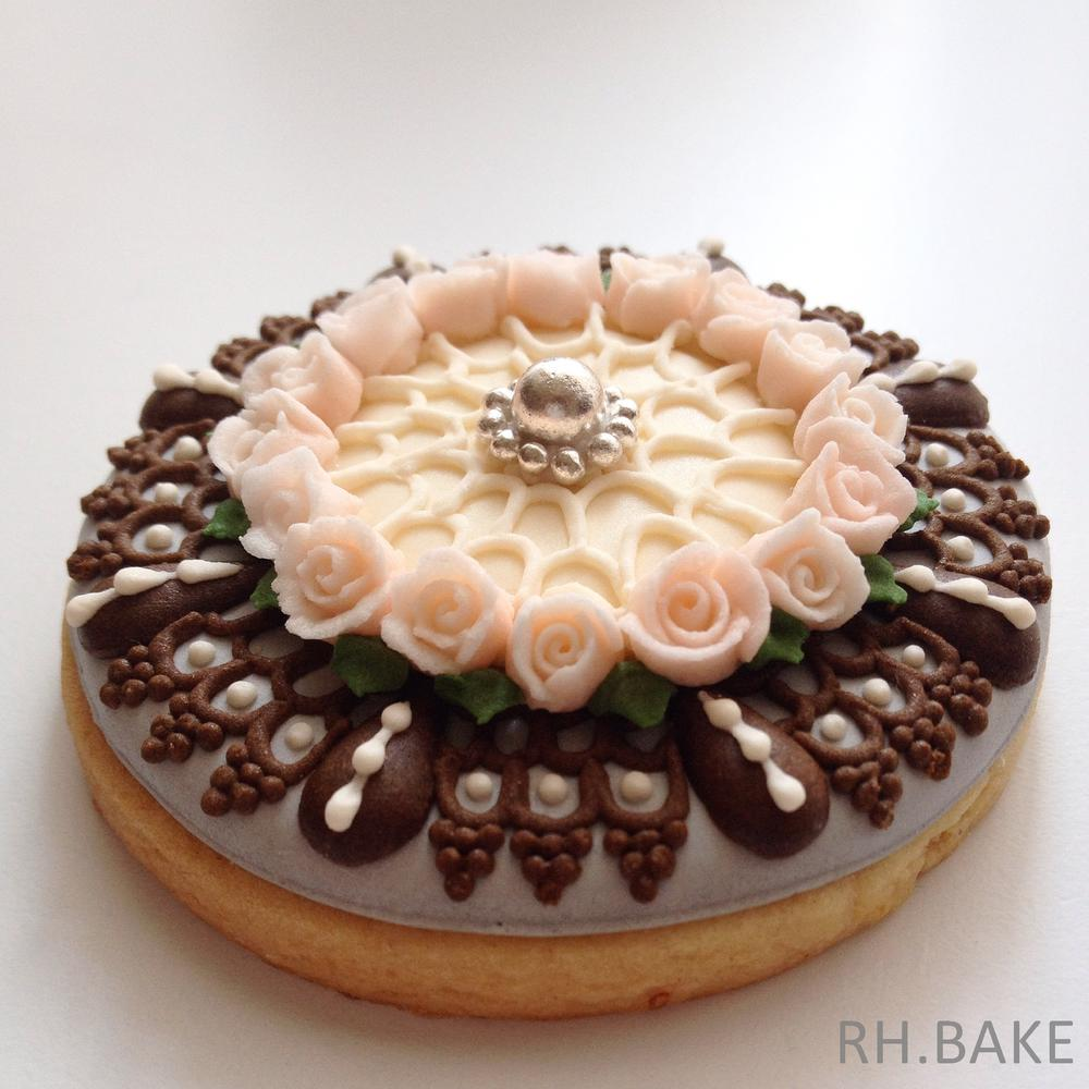 Hand-piped rose cookie