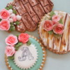 Monogram Cookie and Roses on Wood Paneling