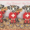 Patriotic Swiss Cows with Knit Sweaters