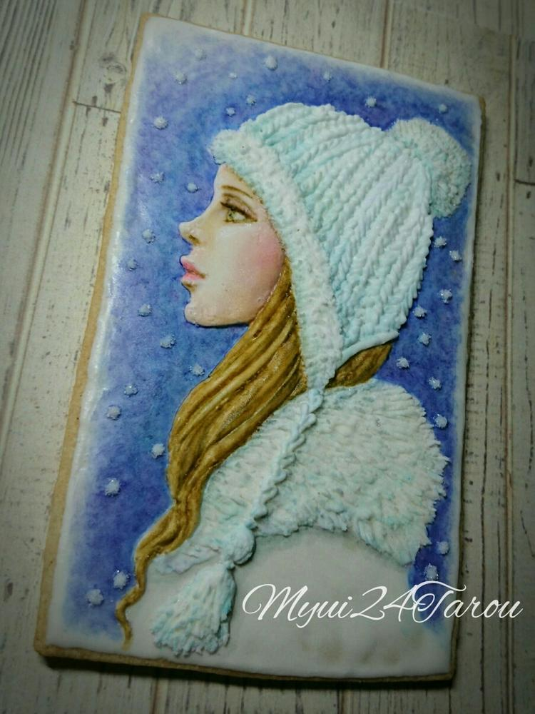 A Girl Wearing a Knit Cap Cookie