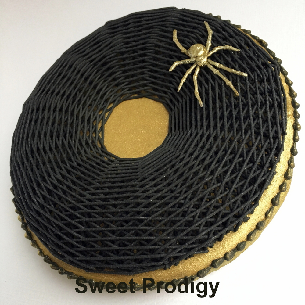 Gold Spider On A Black Web | Sweet Prodigy