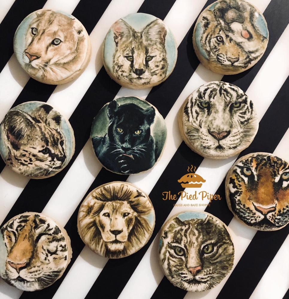 Handpainted Tiger Cookies by the Pied Piper Cakes & Bake Shoppe